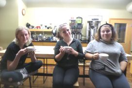 Three female students have a cup of coffee