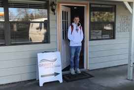 student standing outside the GRAVITY center in Yelm